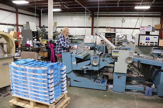 worker at binding machine